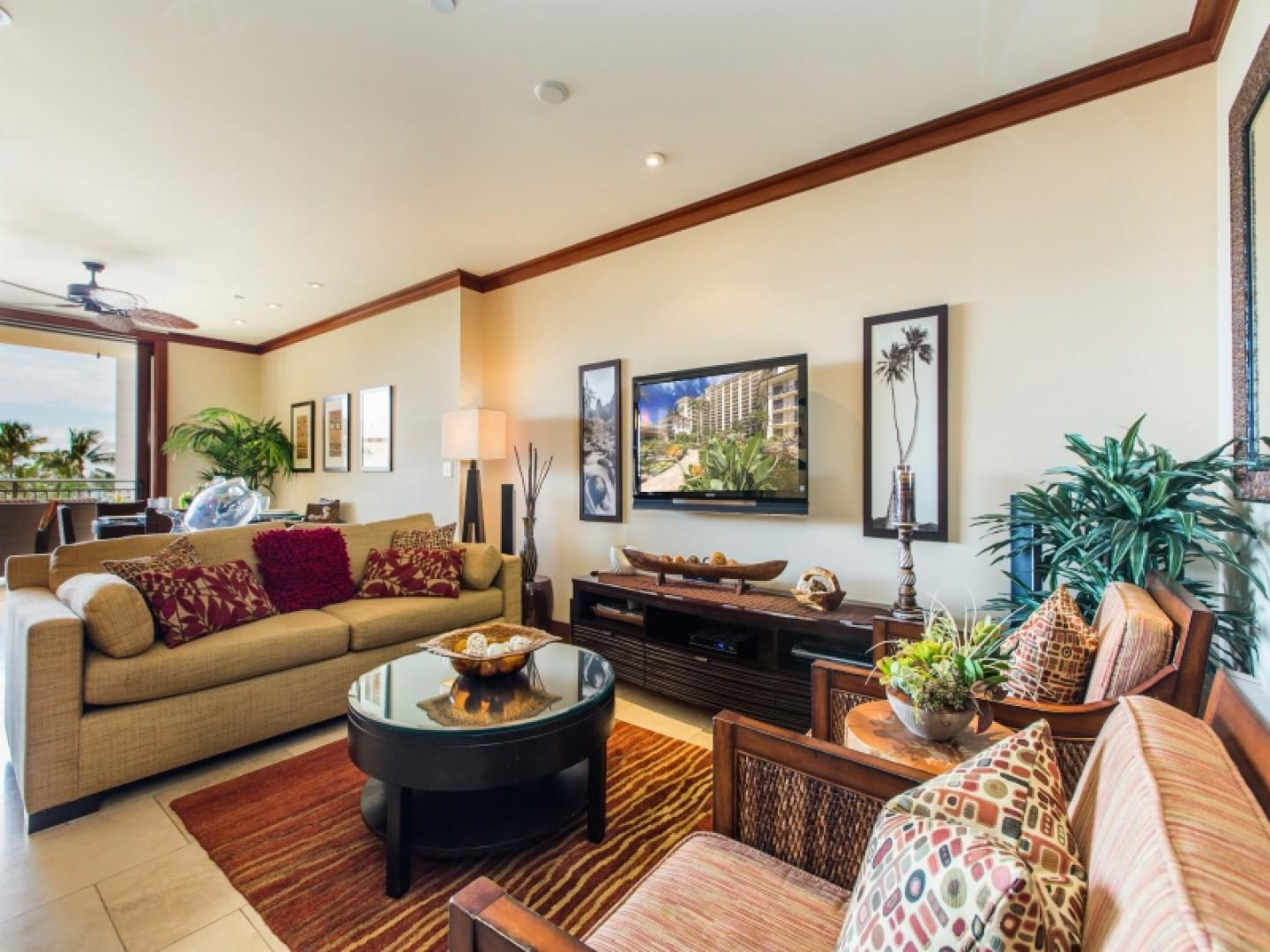 Beautifully decorated living room with flat screen TV and plenty of room to entertain