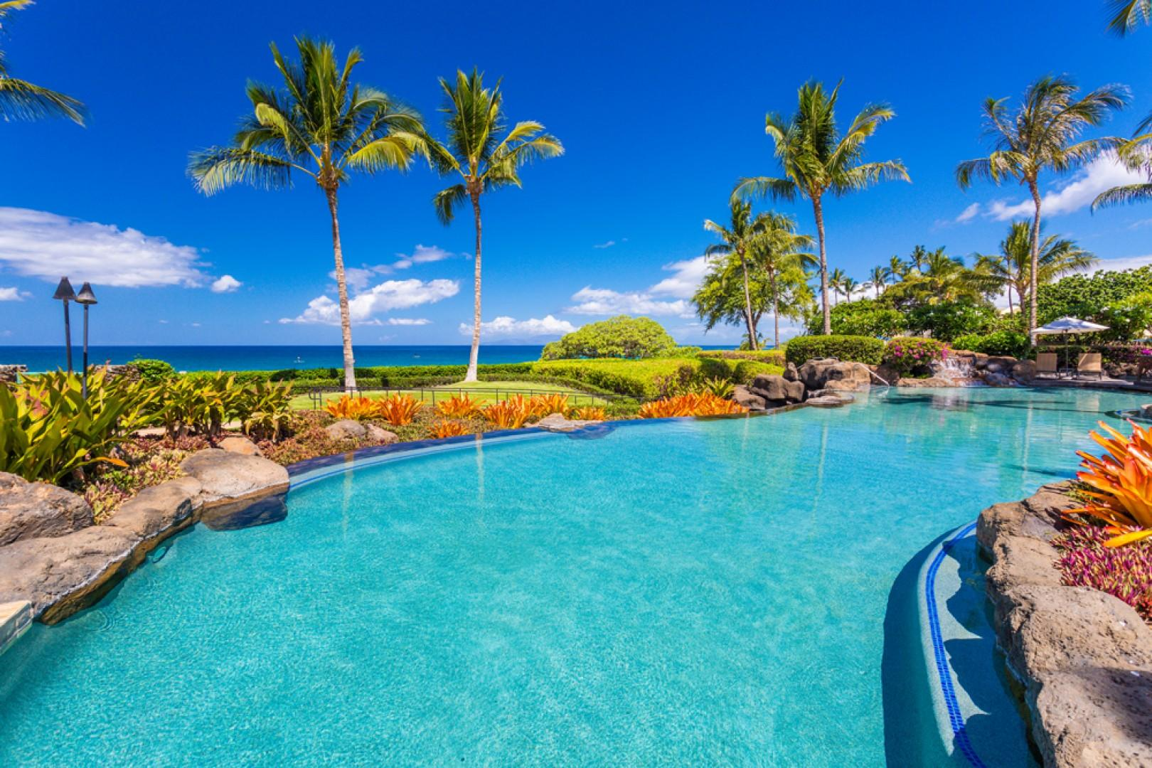 Adults-only infinity-edge heated swimming pool set directly  on Wailea Beach, private for guests of Wailea Beach Villas.