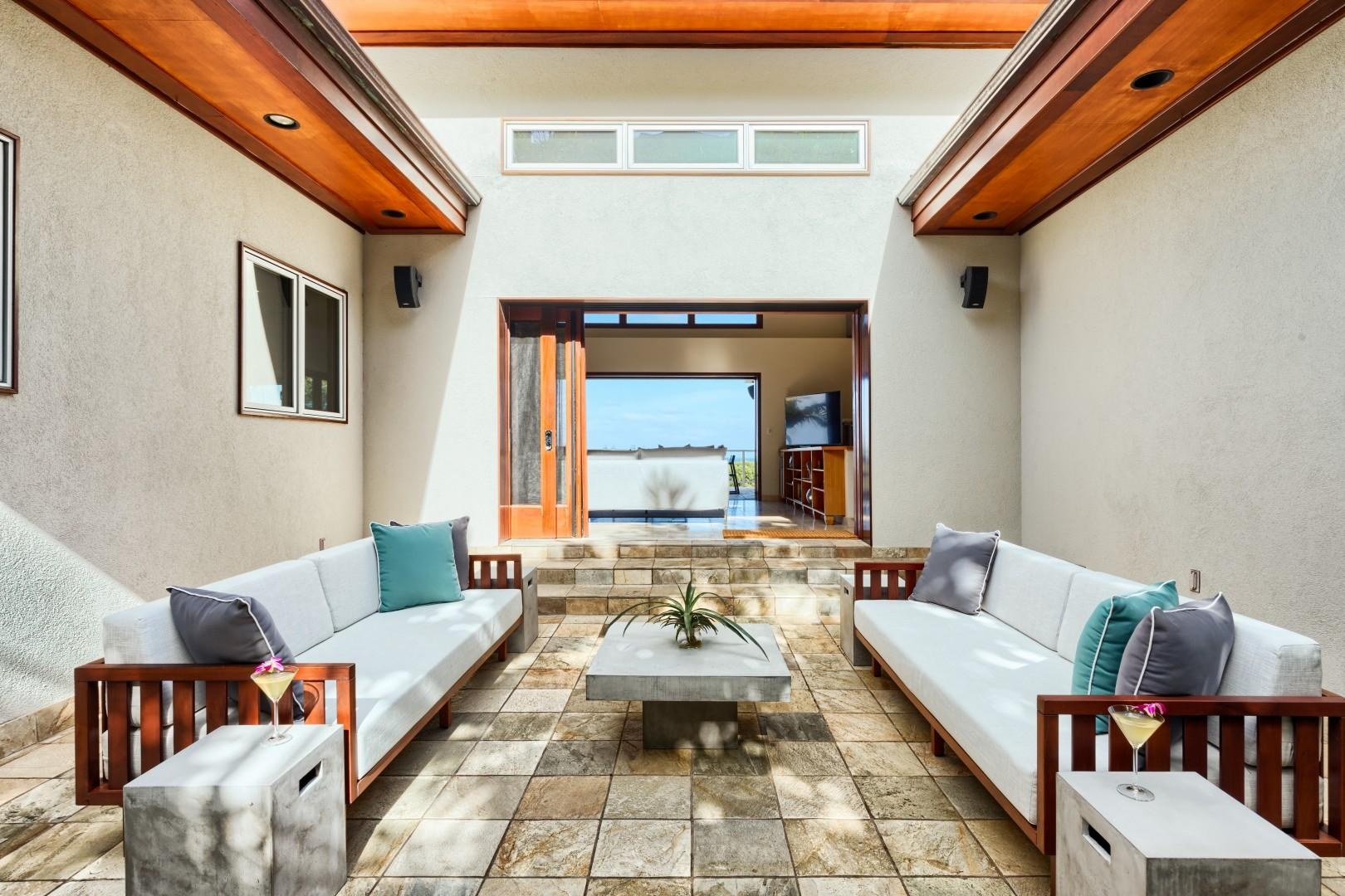 Backyard sitting area, looking out through the house to the ocean.