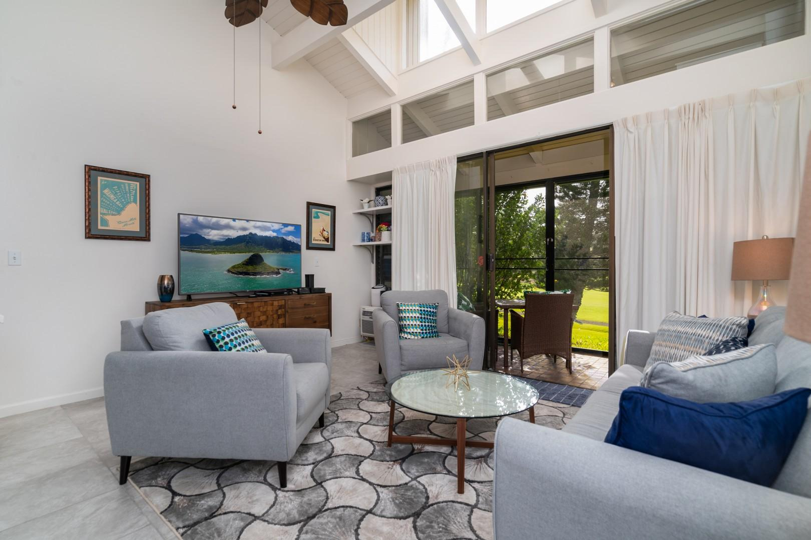 Large-screen television, high ceilings, and a golf course view