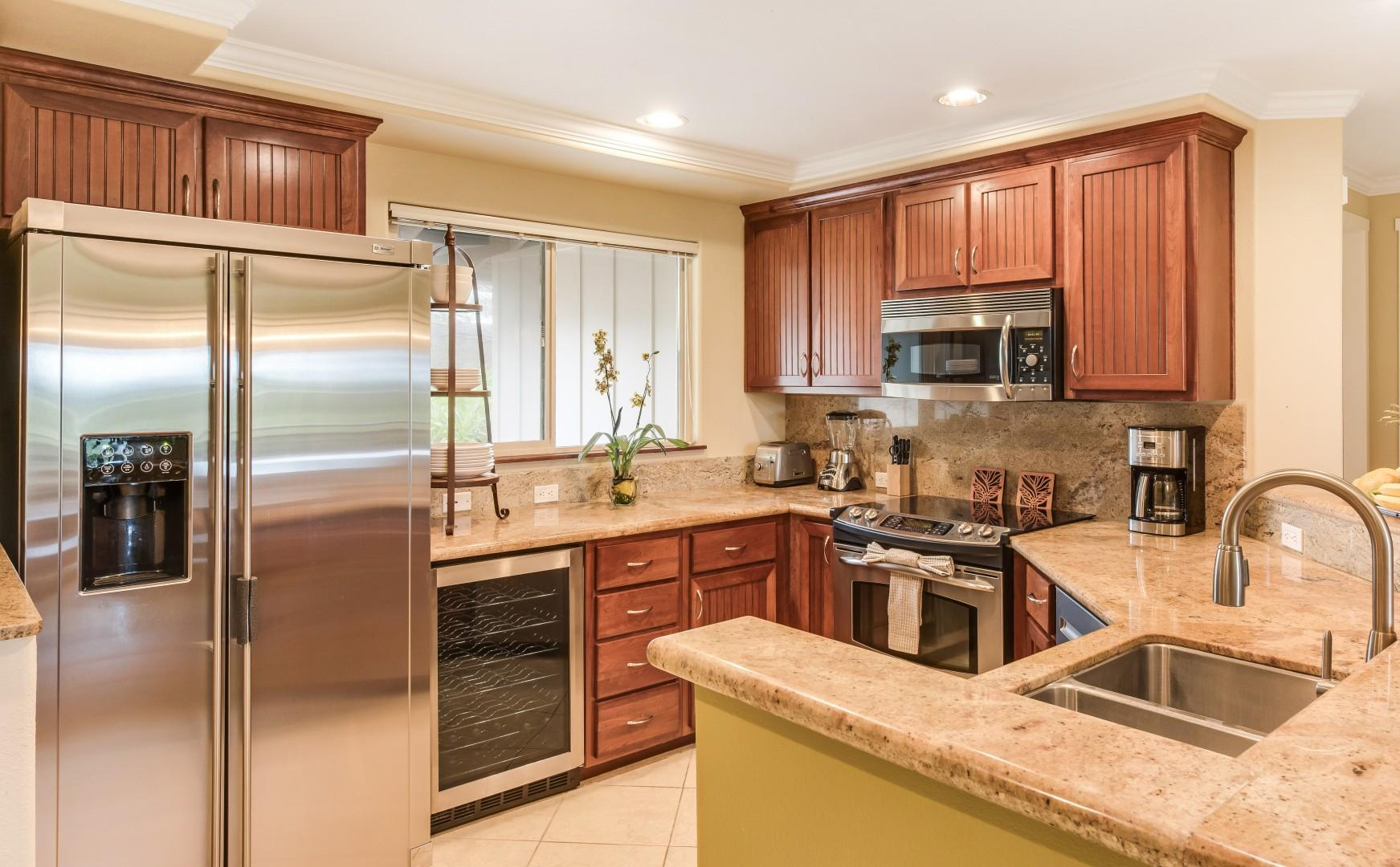 Kitchen w/ Wine Fridge and Granite Counter Tops