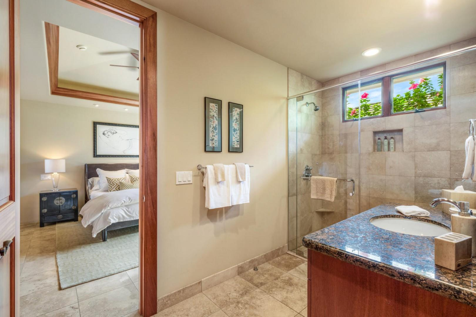 En-suite bath to first guest room with walk-in shower.