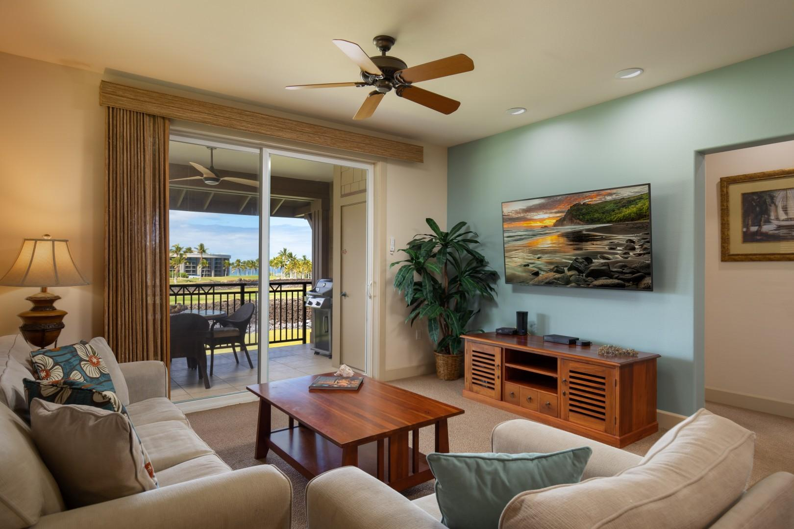 Relax inside in the spacious living room with your smart TV and ocean views.