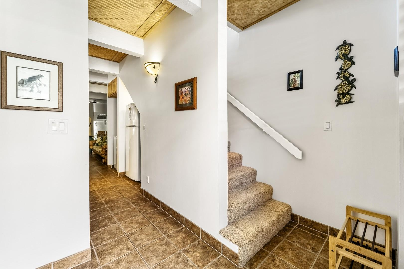 Entry to the condo and stairs leading to the bedrooms