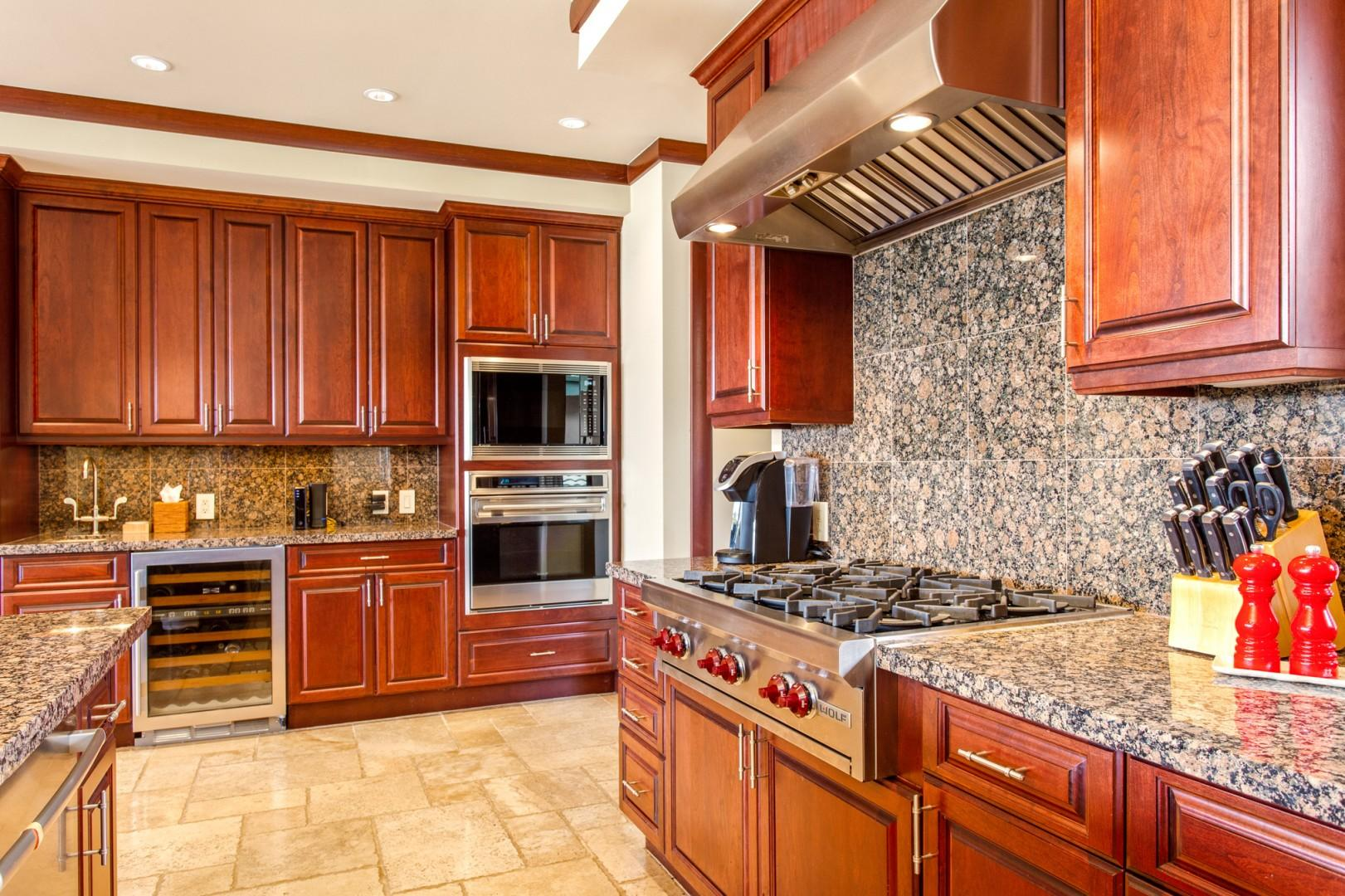 Top tier appliances, a 6-burner gas range, and a wine fridge to delight any chef!