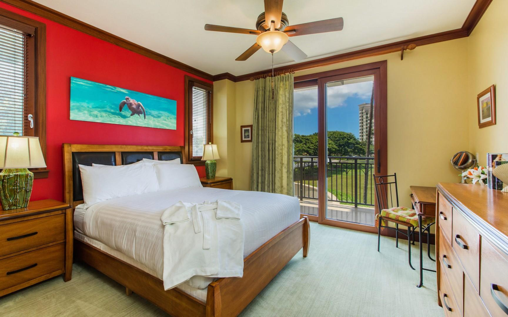 The master bedroom with en suite bath provides beautiful ocean views and convenient lanai access. Ceiling fan, dresser drawers, AC thermostat, separate deep soaking tub and shower, dual sinks, walk-in closet.