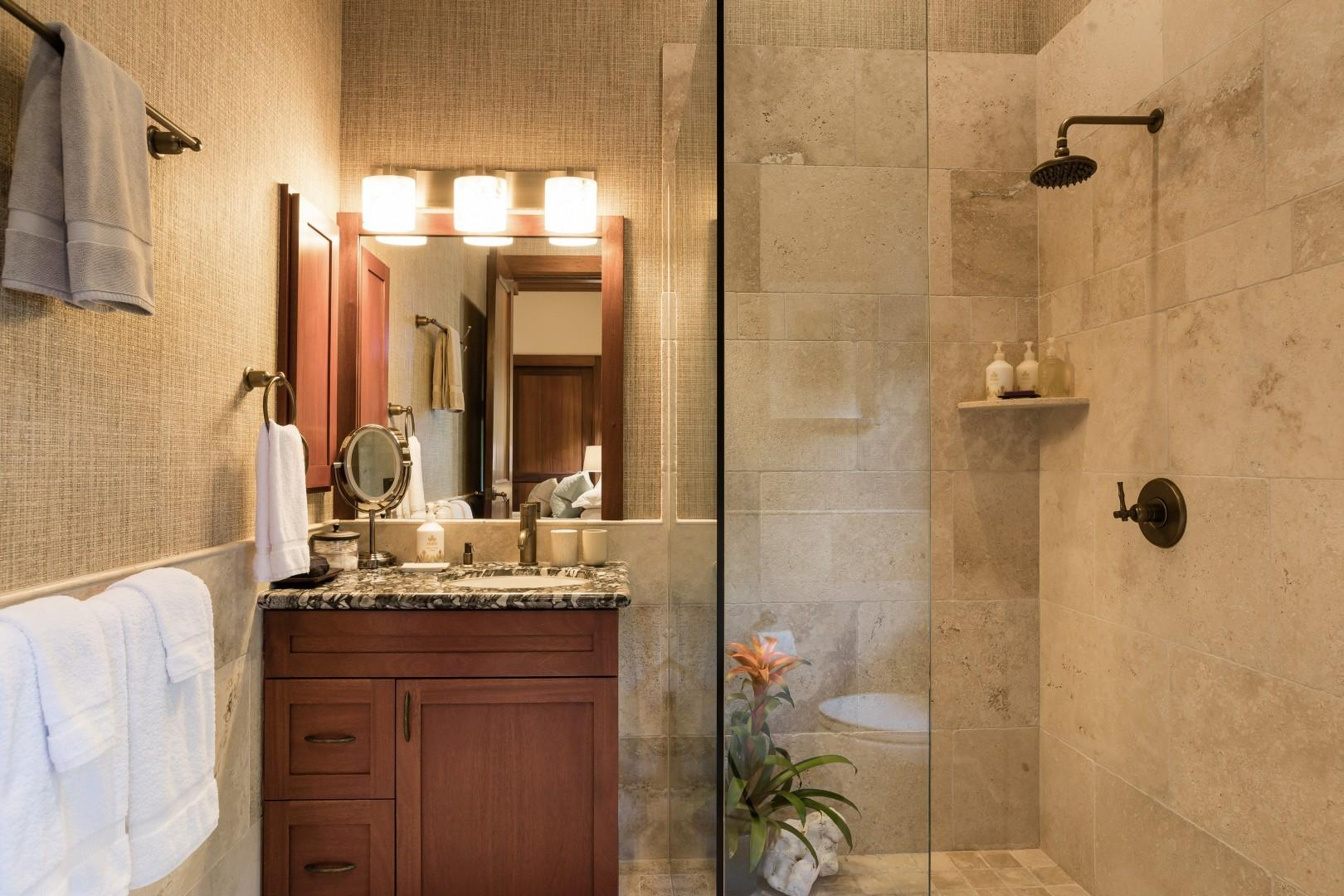 Third bedroom suite's full bath with walk-in shower and granite countertops.