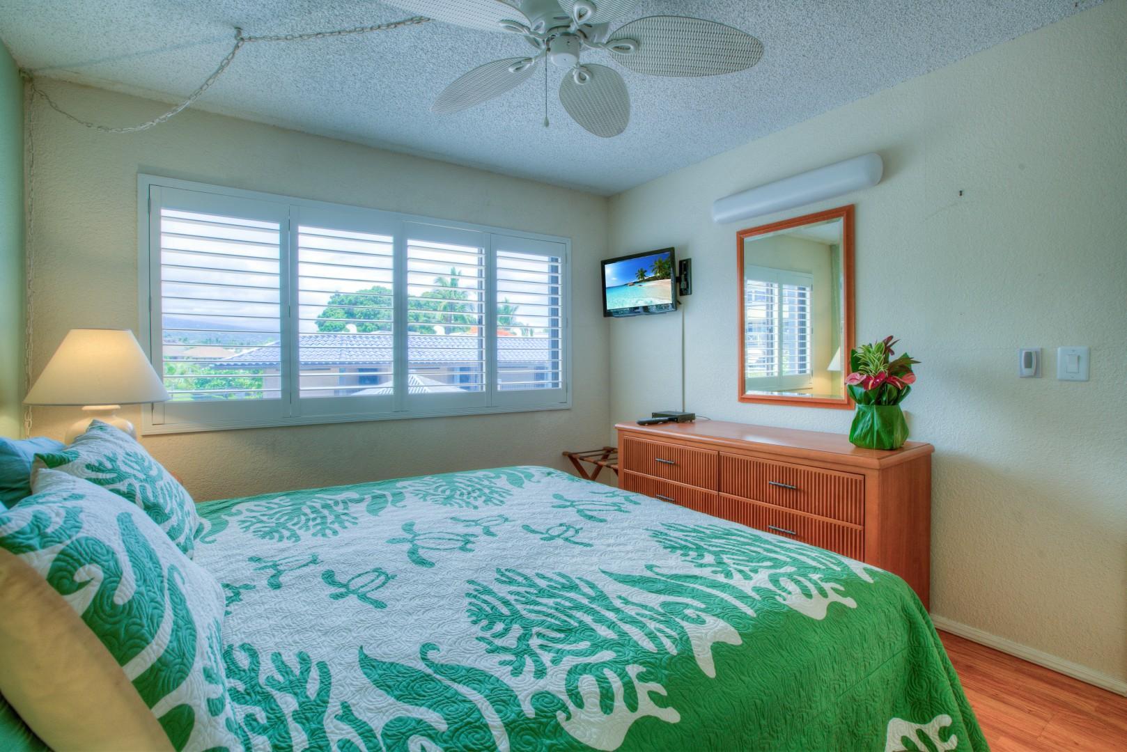 Bedroom has Views of Hualalai Mountain through Plantation Shutters.