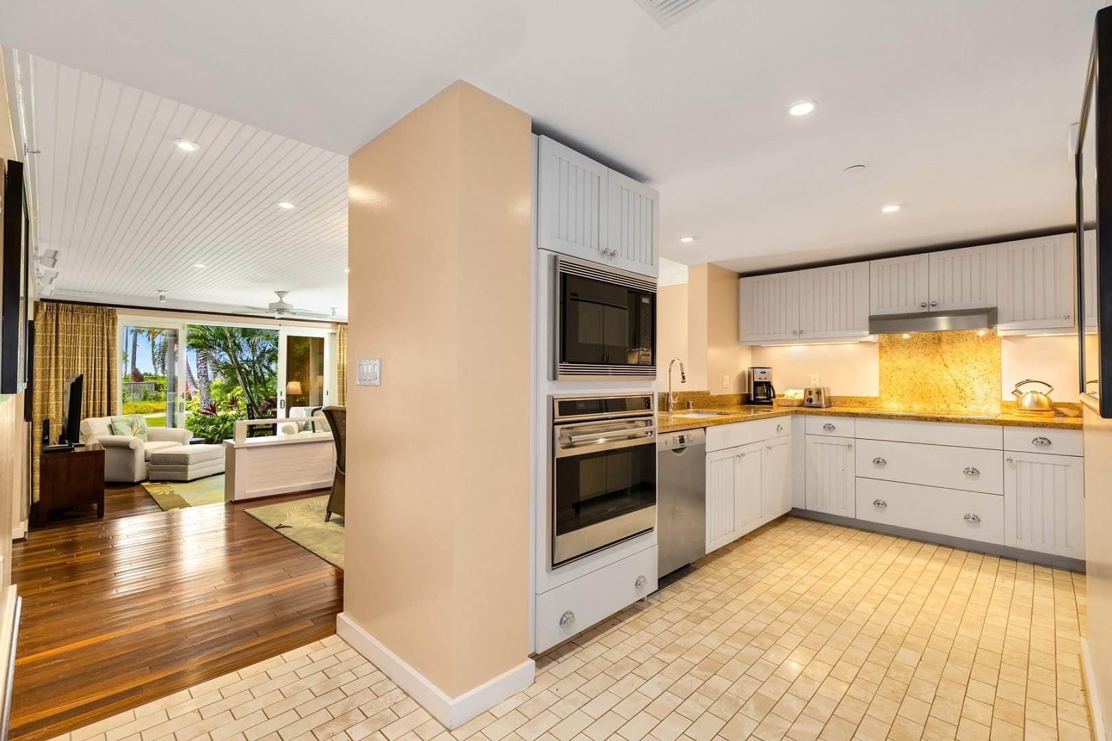 Kitchen with a clear view into the dining area and out into the beautifully landscaped garden.
