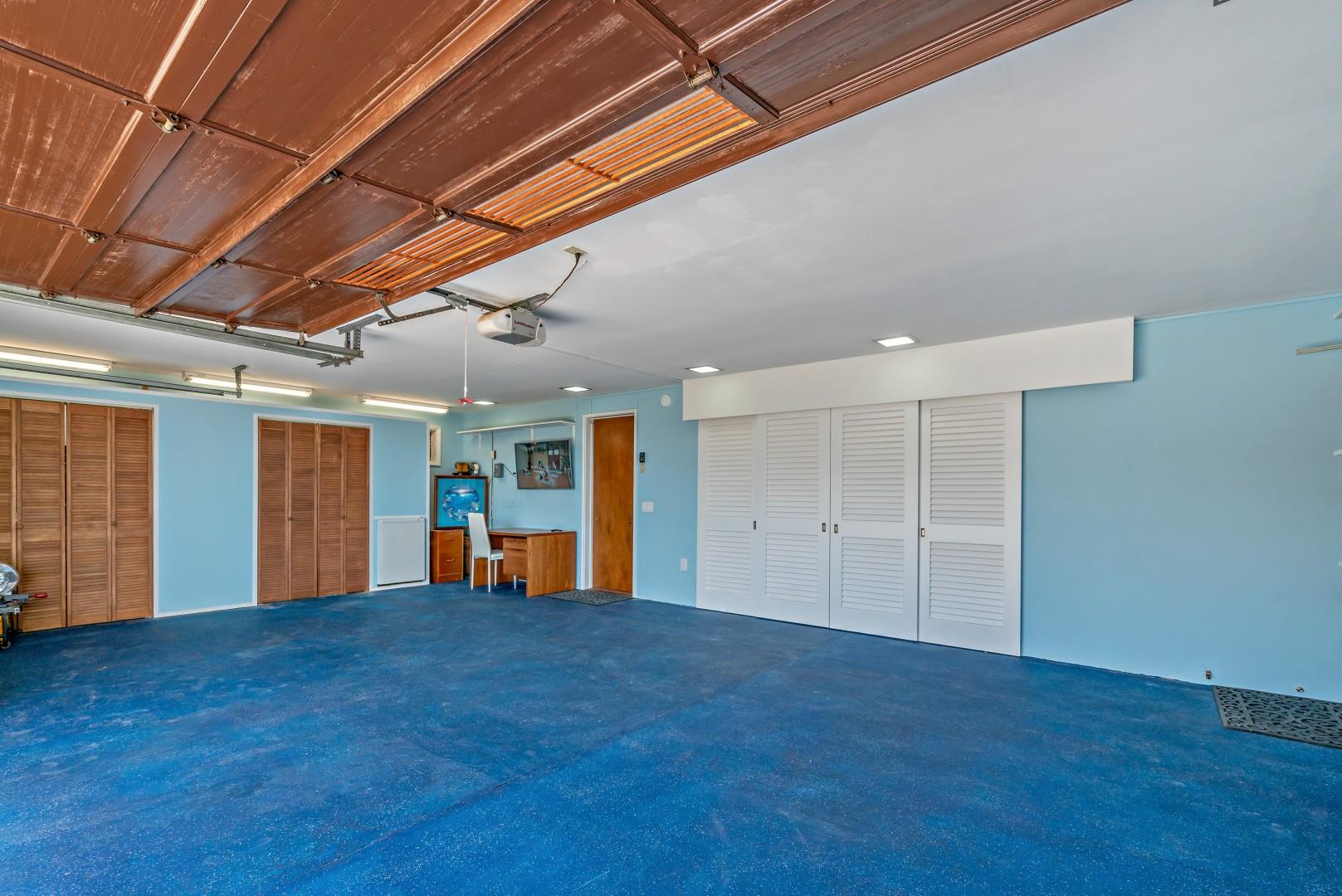 Plenty of Parking in this 3 car garage. With full size washer dryer and wash sink. Dedicated area for fitness and yoga with TV for streaming your motivational or training videos.
