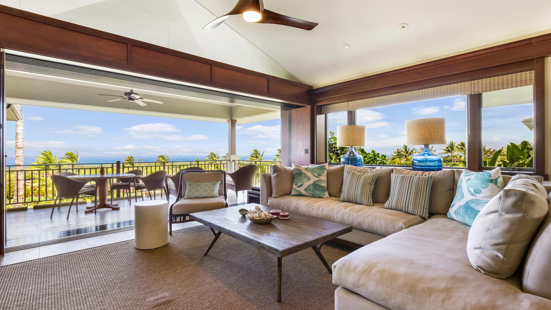 Living room and lanai with ocean views.