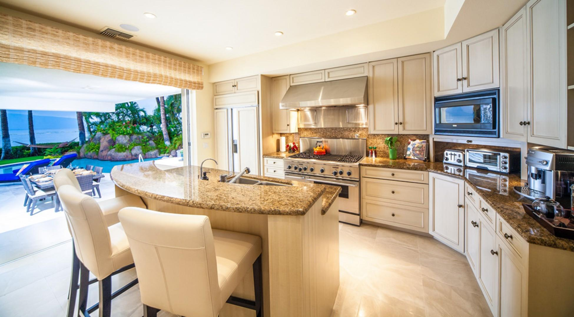 Opal Seas At Baby Beach - Poolside Kitchen with Fabulous Gas Range, Wine Fridge, Espresso Maker, Gourmet Cookware, TV, and a full array of New Supplies and Equipment. Outdoors there is an Ice Maker, Bar Fridge, and Gas BBQ Grill.