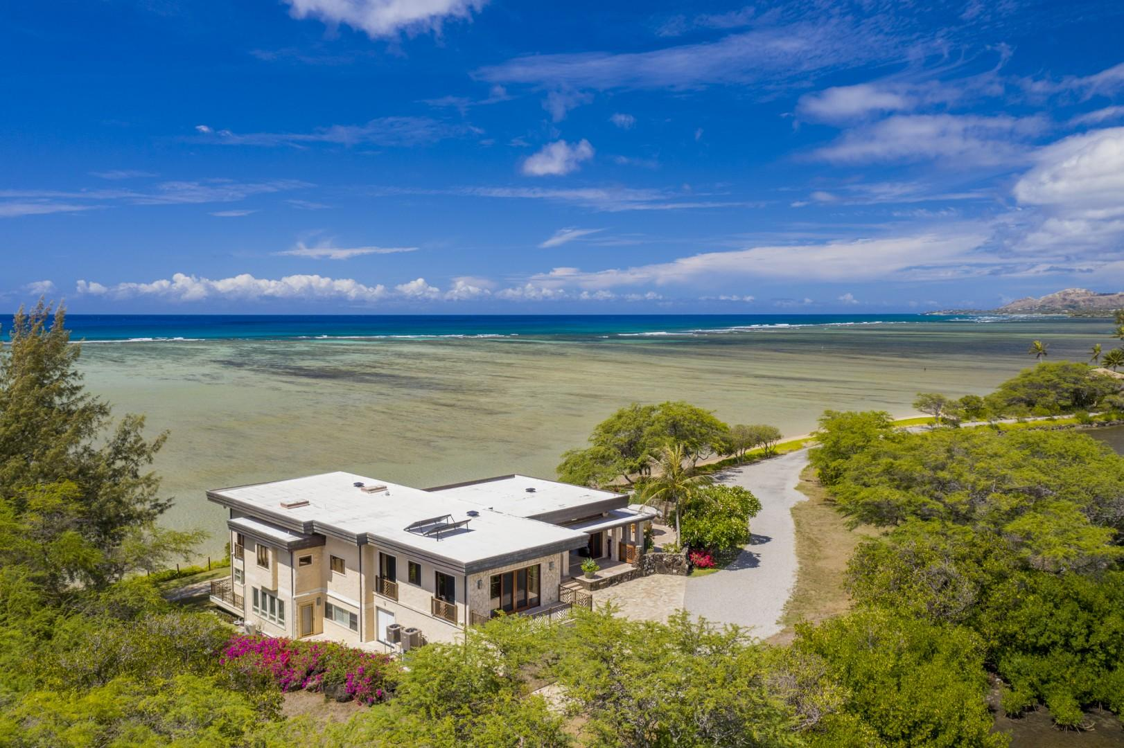 Aerial view looking down on Paiko Lagoon Island estate towards private driveway
