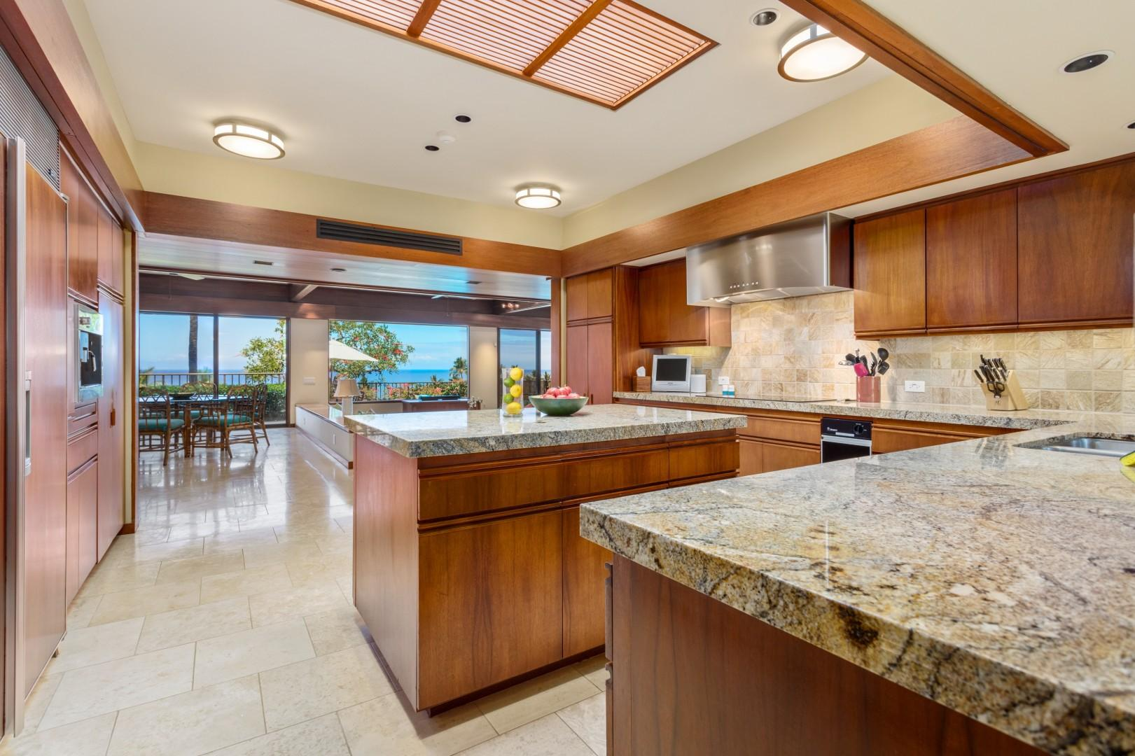 Ocean Views from the Spacious Open Kitchen w/Granite Countertops & Top-Tier Appliances.