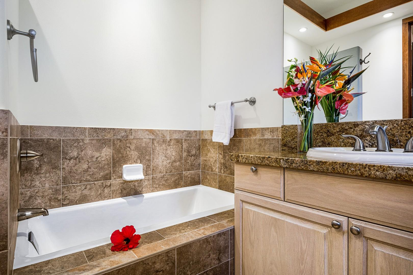 Large soaking tub and standing shower can be found in the Master bathroom