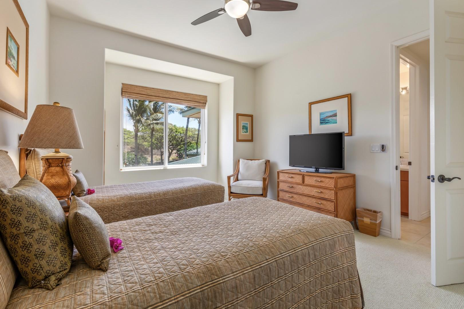 Guest bedroom with two twin beds (can convert to a king upon request) andmountain views.