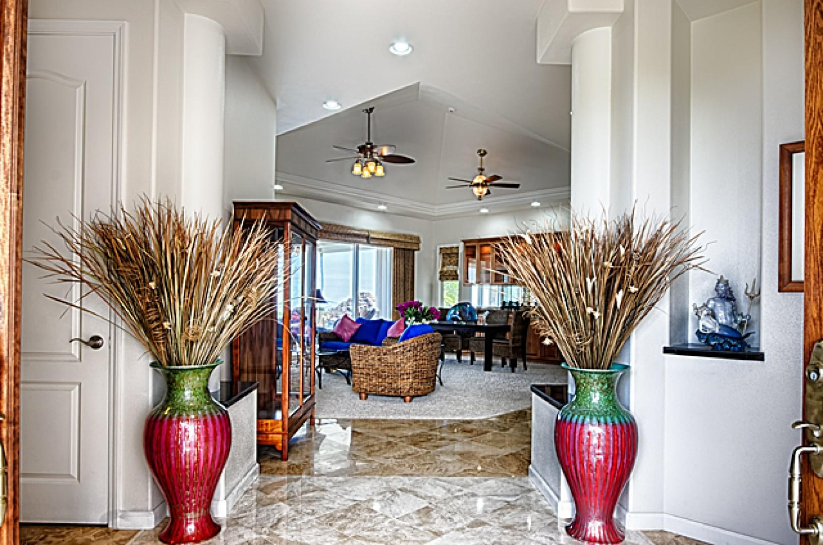 The grand entry way from the front door to the living room.