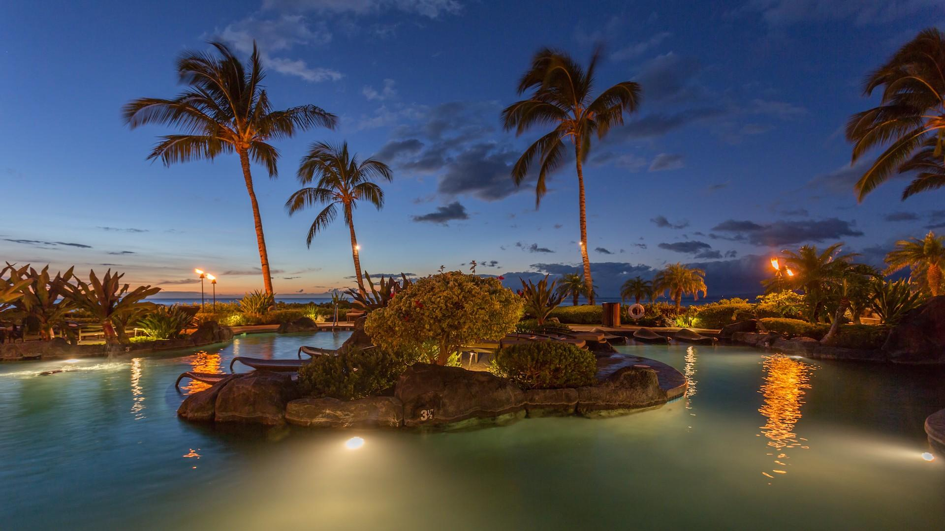 Hali'i Kai Resort's private lagoon-style saltwater pool at dusk.
