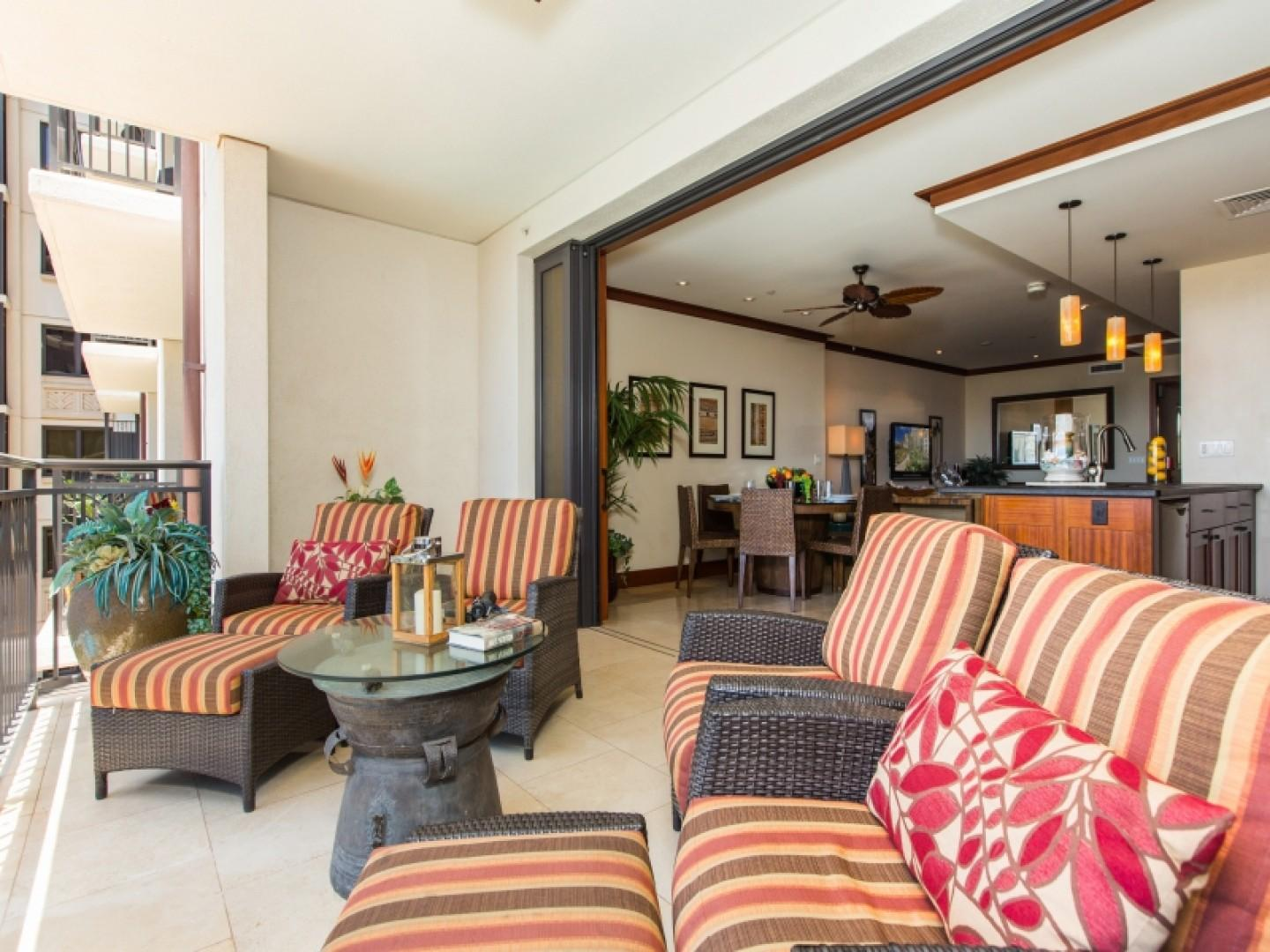 Shaded lanai with plenty of comfortable seating options