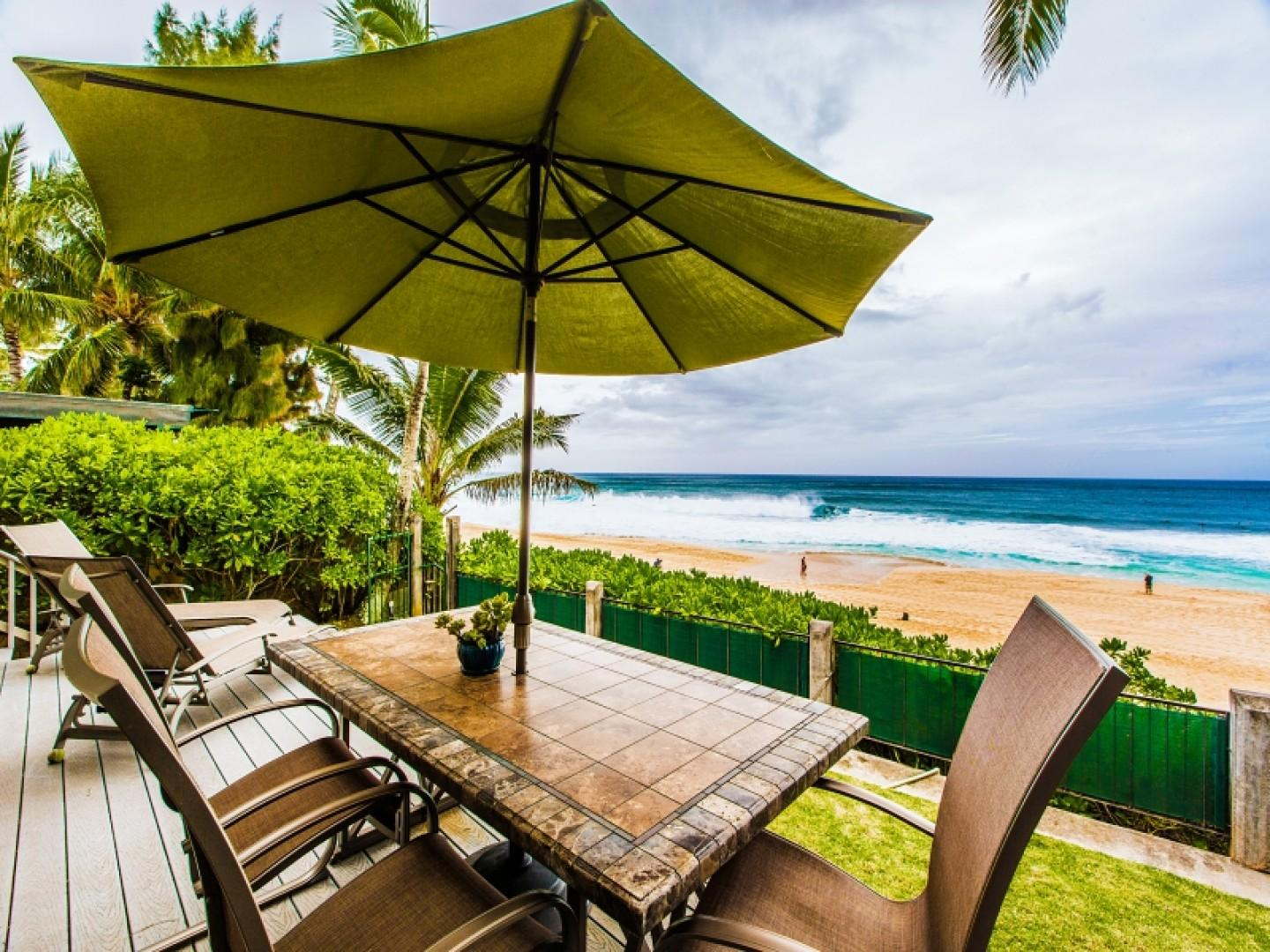 Lanai dining area, just steps from the ocean.