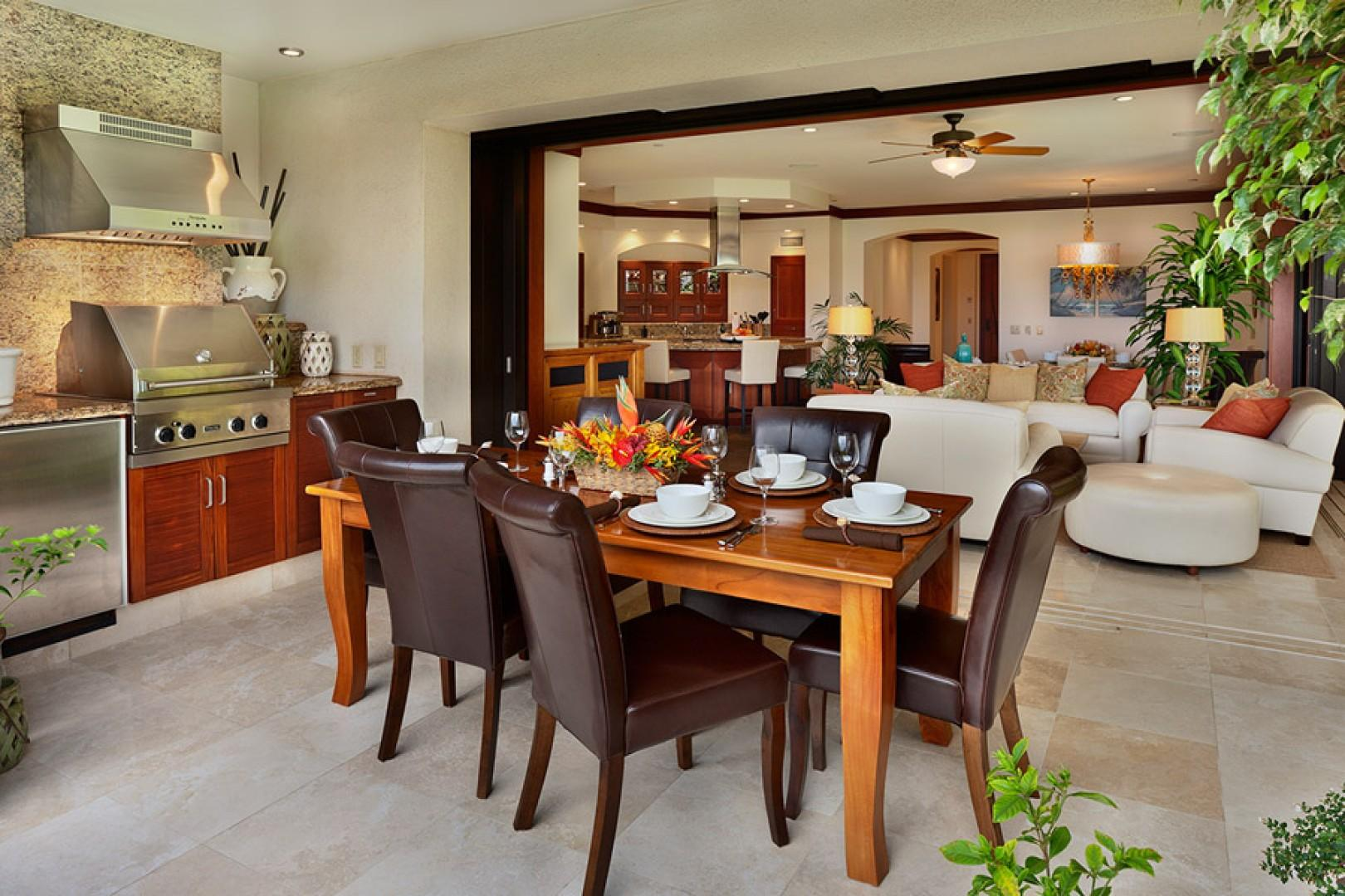 A view from the outdoor dining area into the living space.