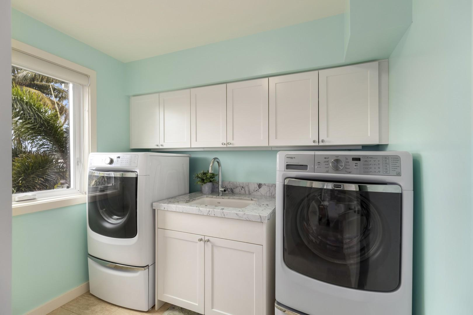 Dedicated laundry room with full-size washer and dryer.