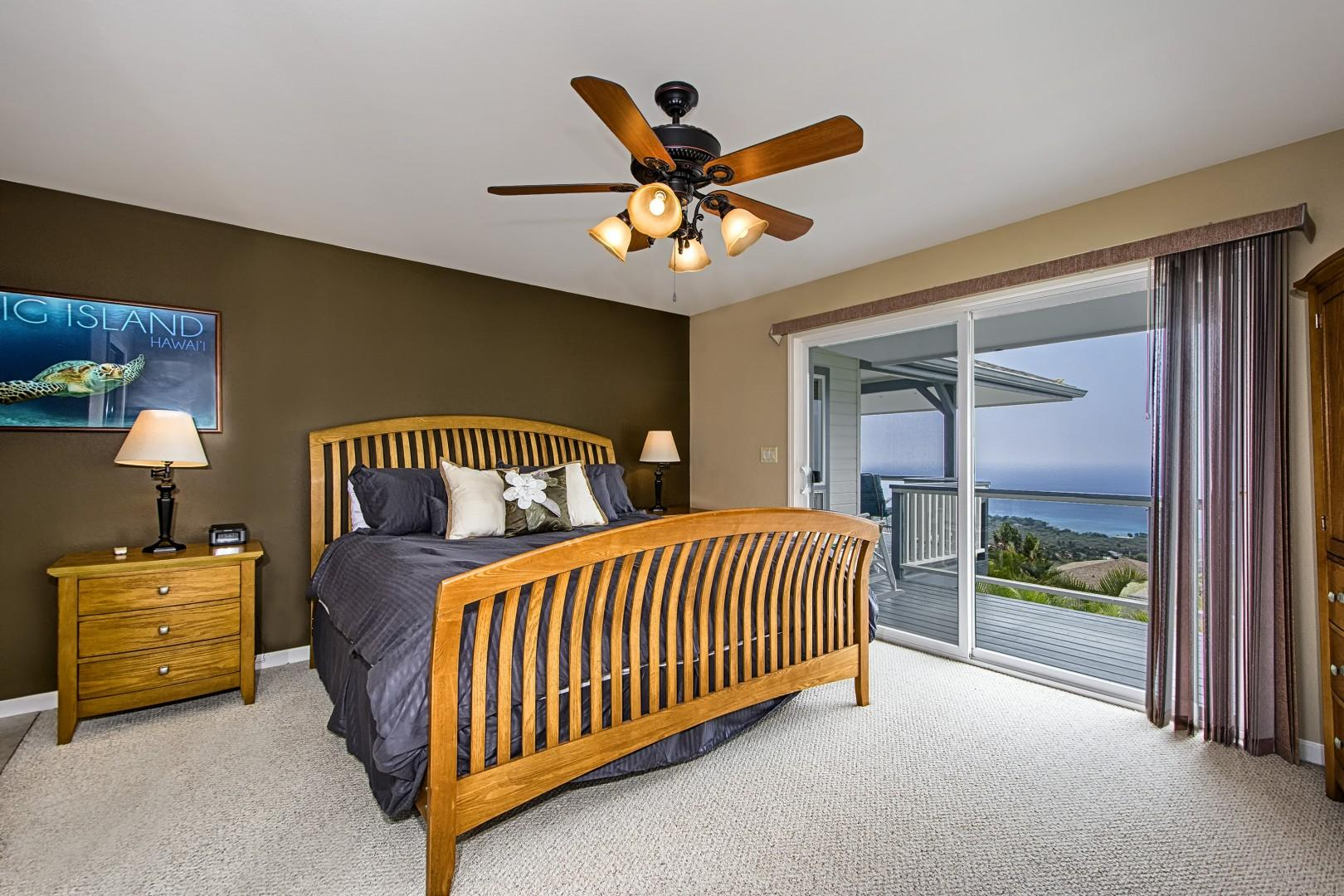 Master bedroom featuring a king sized bed and Lanai access