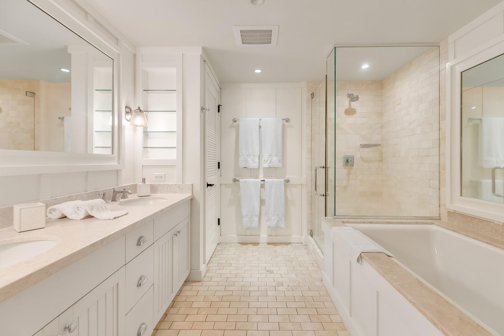 Master ensuite with soaking tub, separate shower, and private lavatory