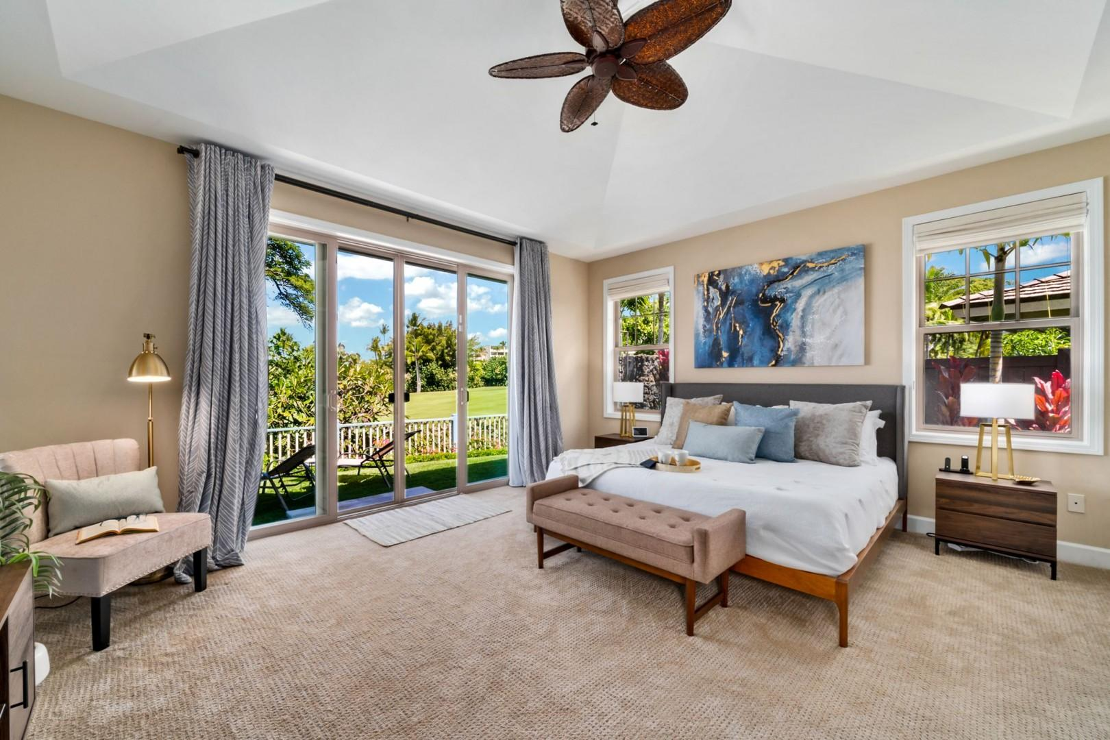 Master bedroom equipped with King bed, A/C, Lanai access, TV , and work space