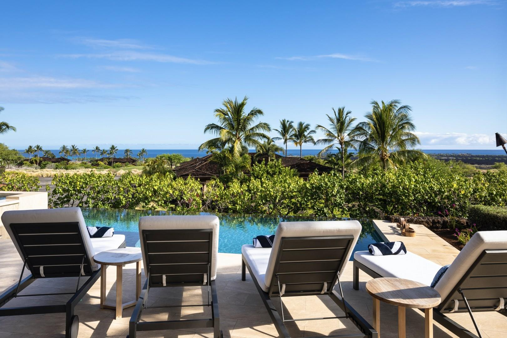 Poolside loungers offer endless relaxation opportunities.