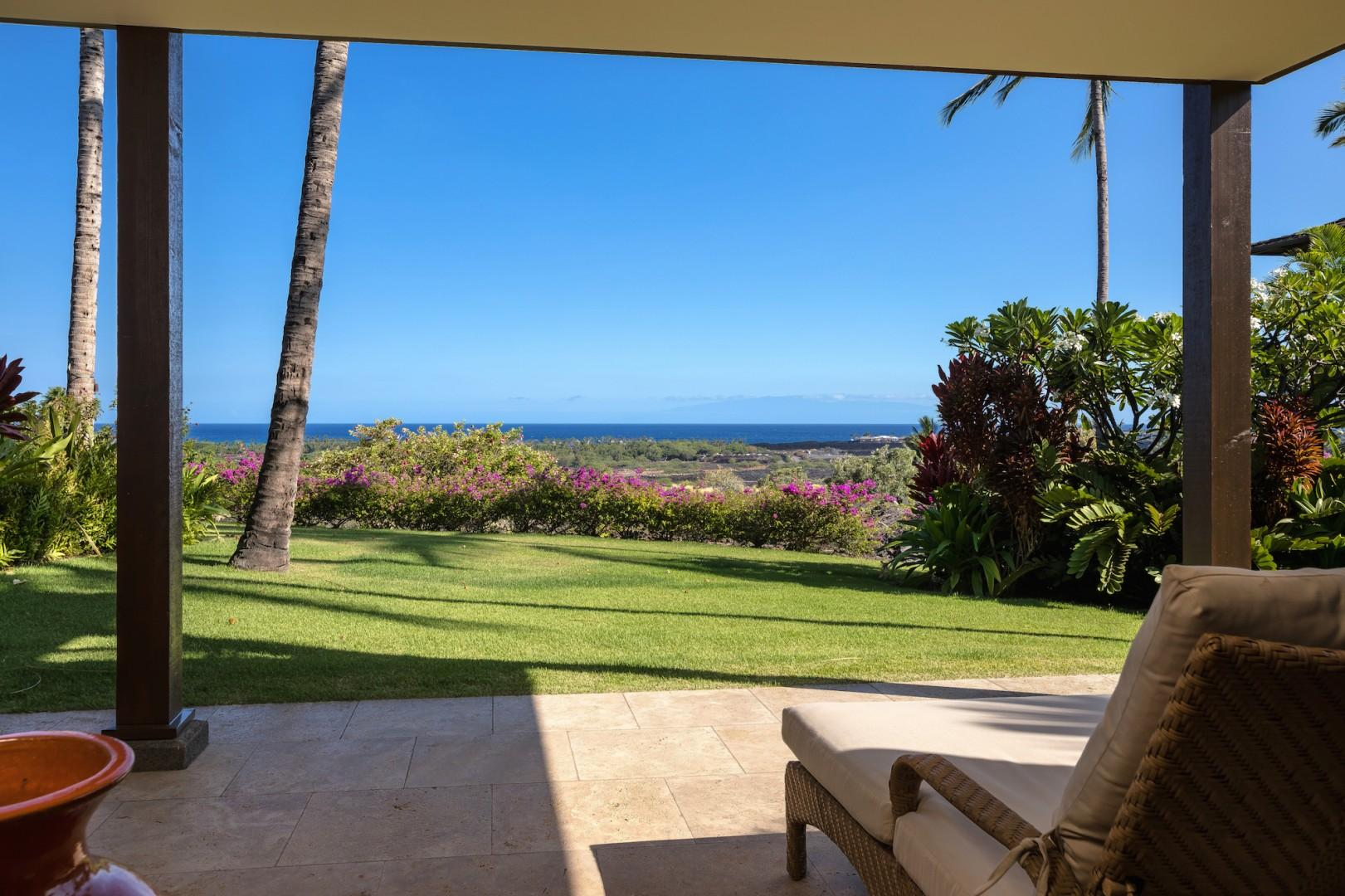 Den with private lanai offering a panoramic ocean view.