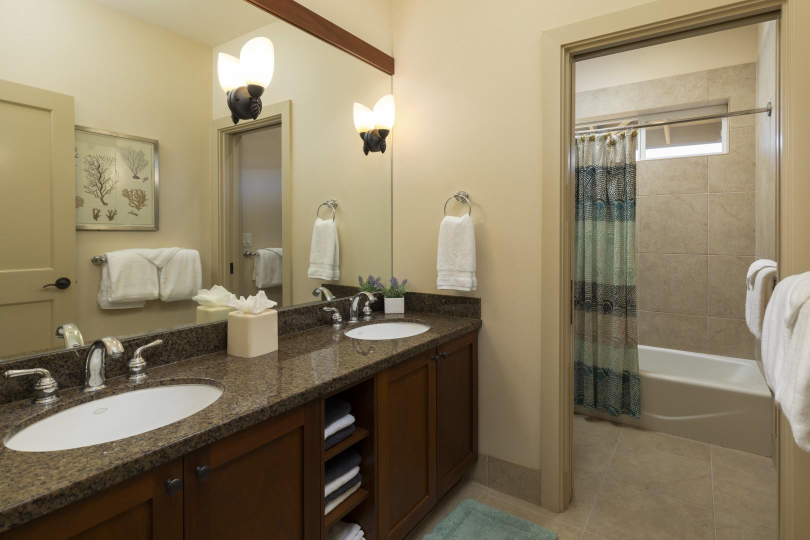 The guest suite bathroom offers dual vanities and a tub/shower combination.