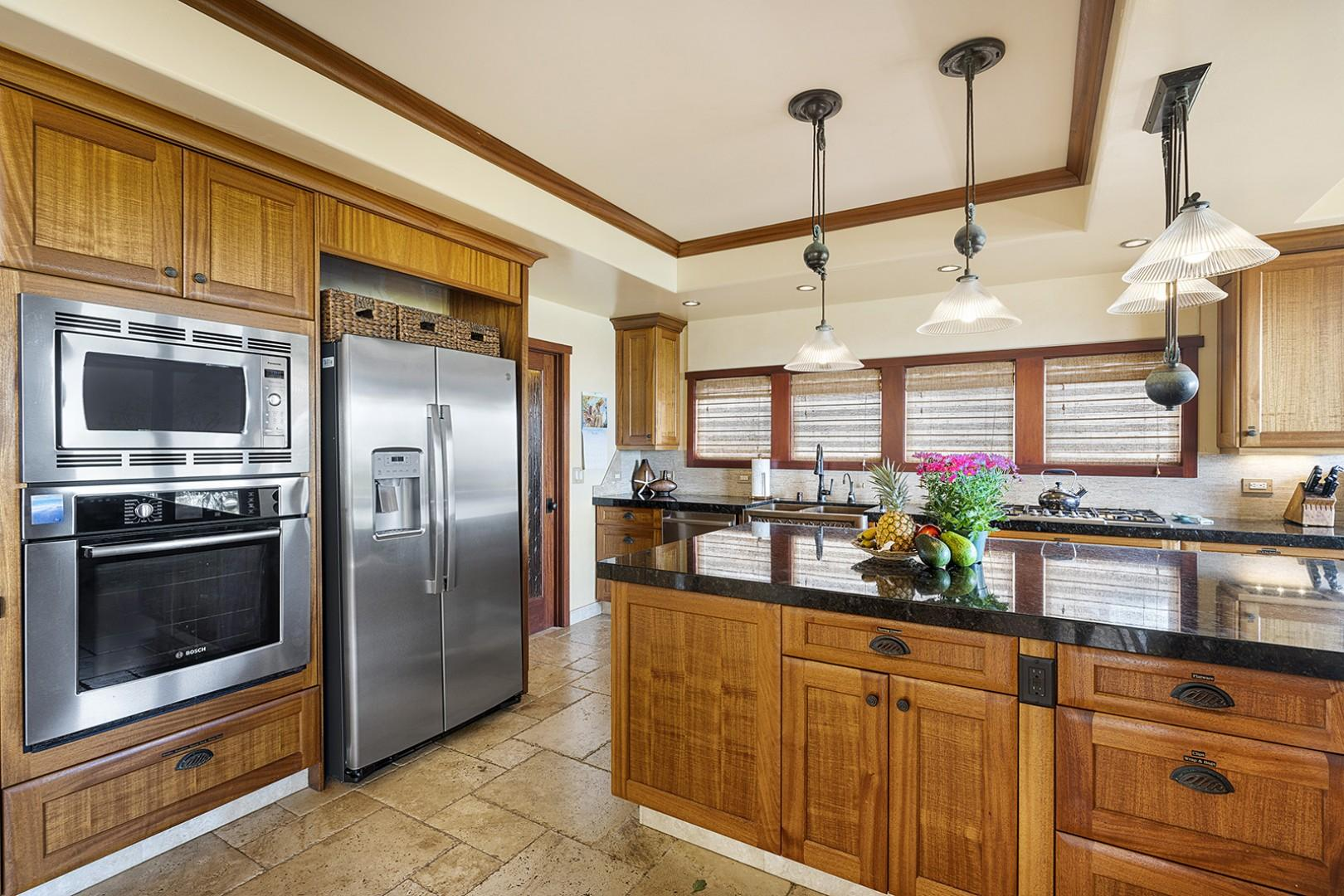 Kitchen features a wine fridge and gas range