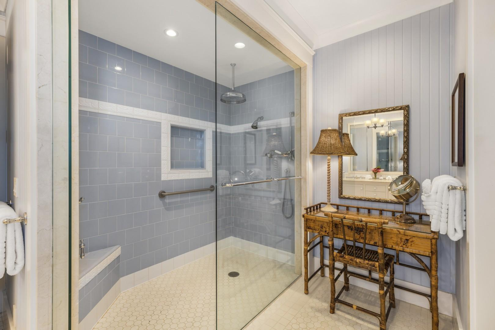 Walk-in shower with three showerhead options: rainfall, wall, or handheld