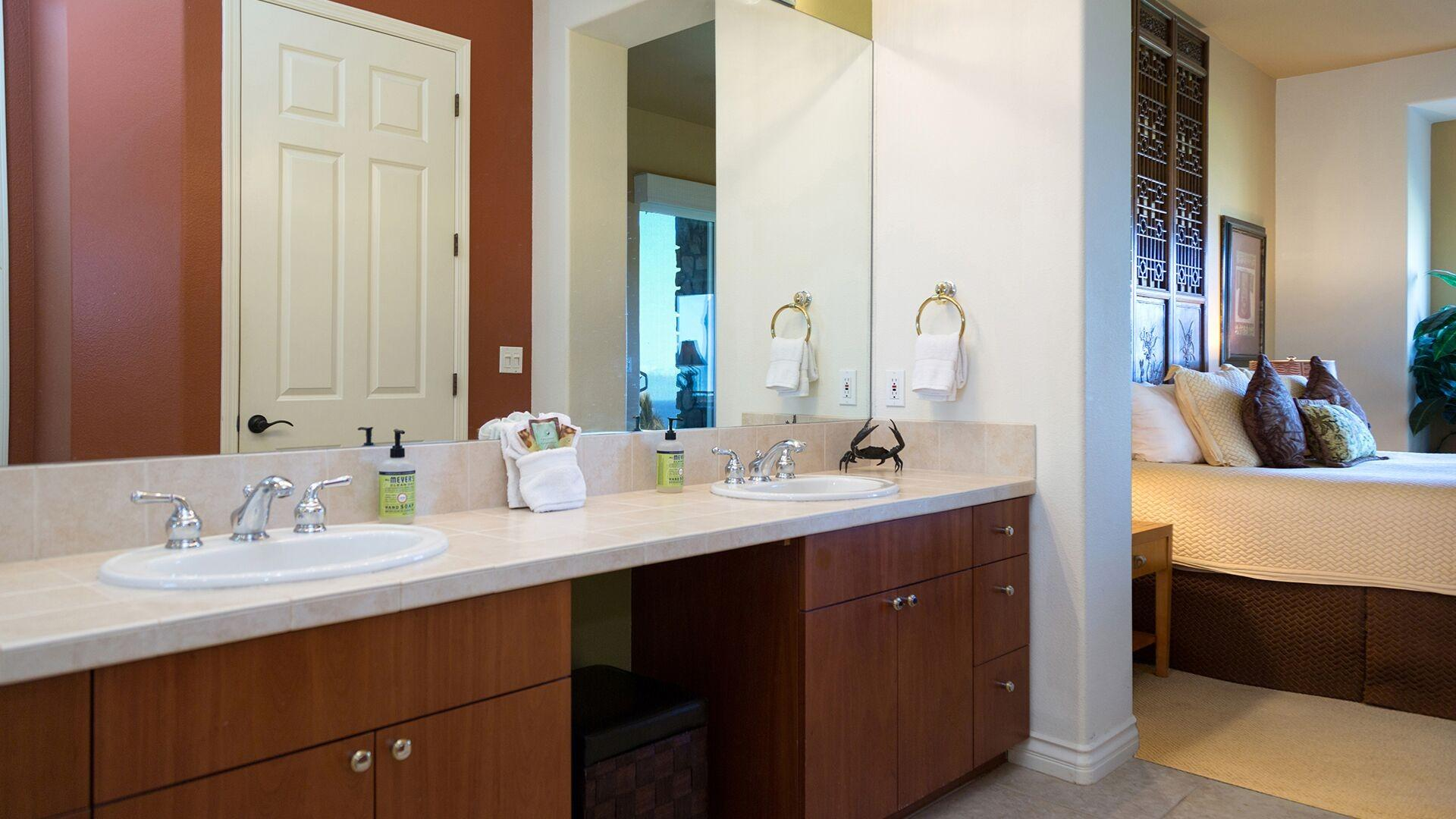 En-suite Master Bathroom with double vanities and conveniently leads to the Bedroom.