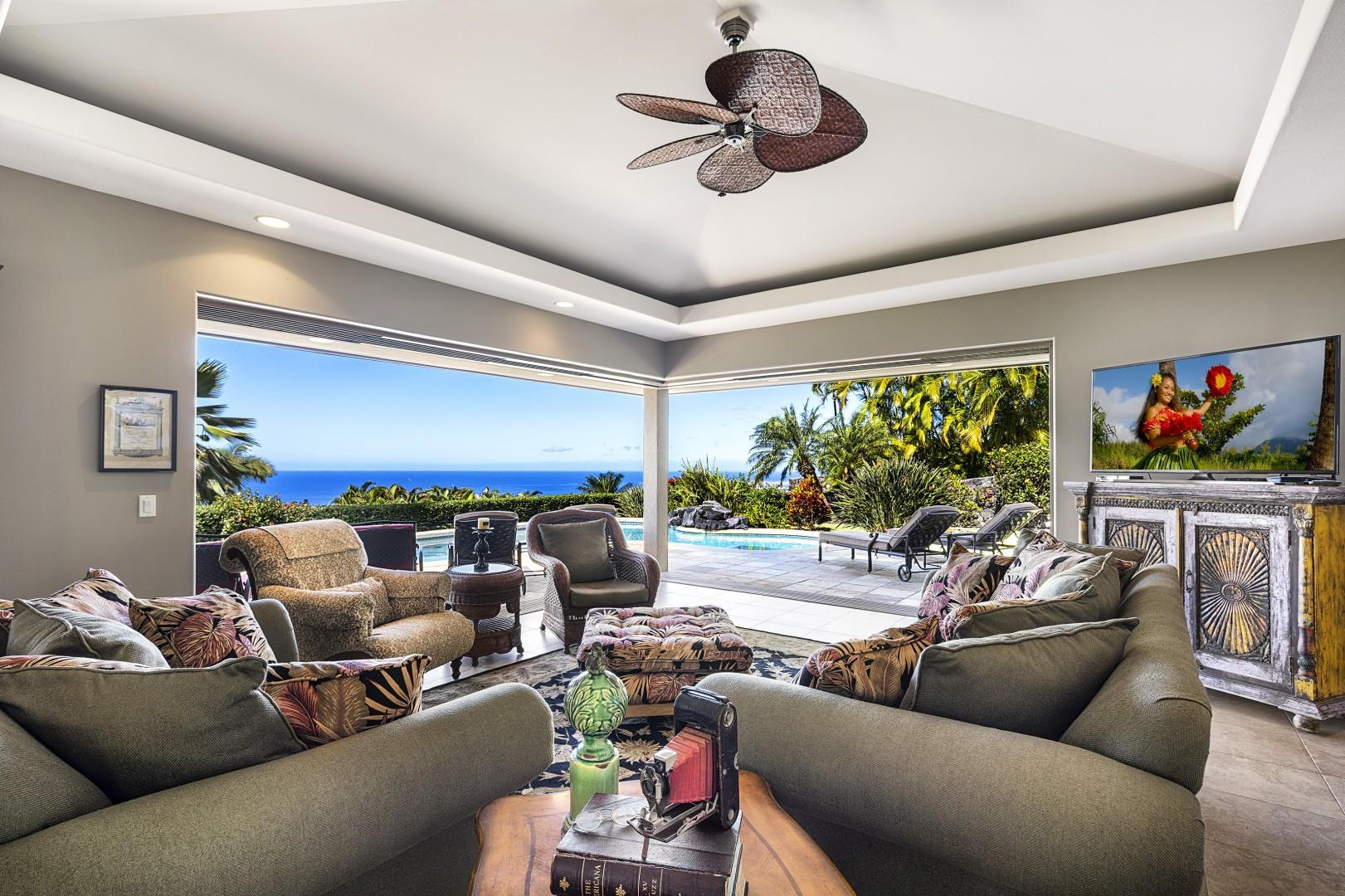 Large pocket doors bring the outside in with this Tropical design!