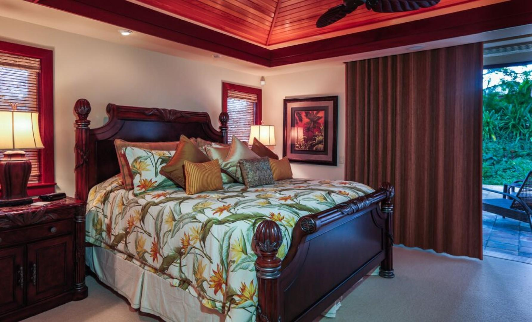 Master bedroom with large sliding doors leading out to a beautiful garden lanai
