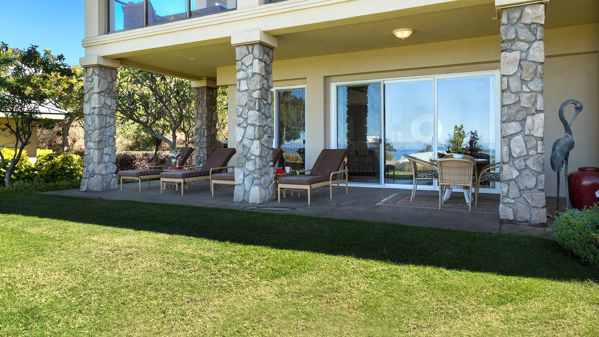 The expansive lanai provides plenty of room for the entire family to relax and enjoy.