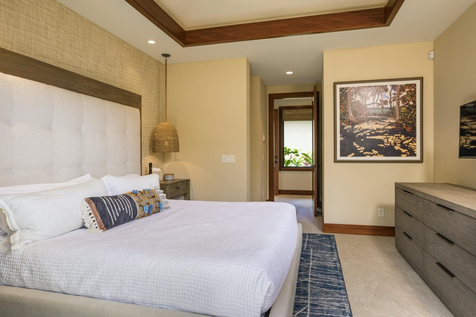 Reverse view of guest bedroom two featuring king-sized bed, wall mounted flat screen TV and valanced ceilings.