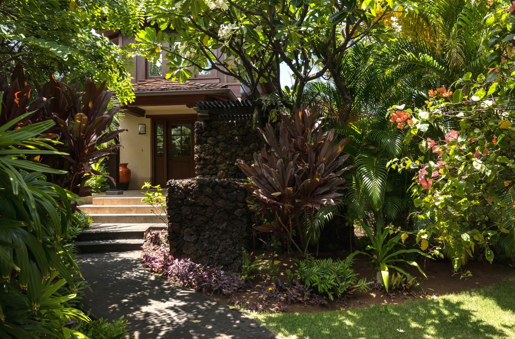 Gorgeous tropical landscaping leads to your private villa entrance.