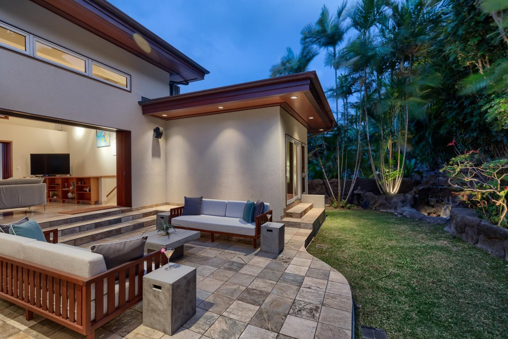 View of the serene backyard from the jacuzzi and barbecue area.