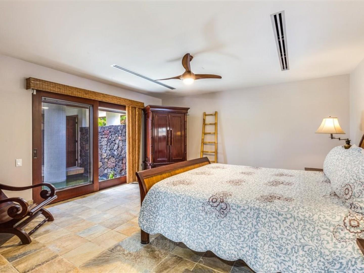 25-Bedroom looks out to the beautiful koi pond!