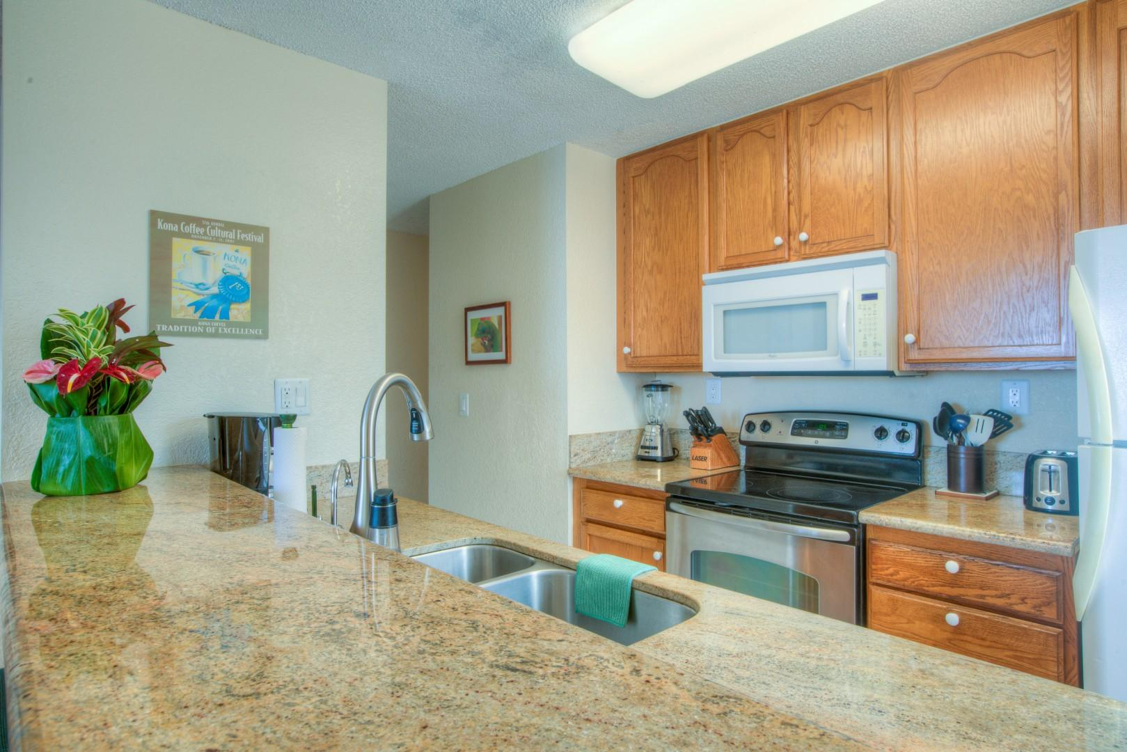 Kitchen has Granite Counters, Upgraded Cabinets, and Bar-seating.