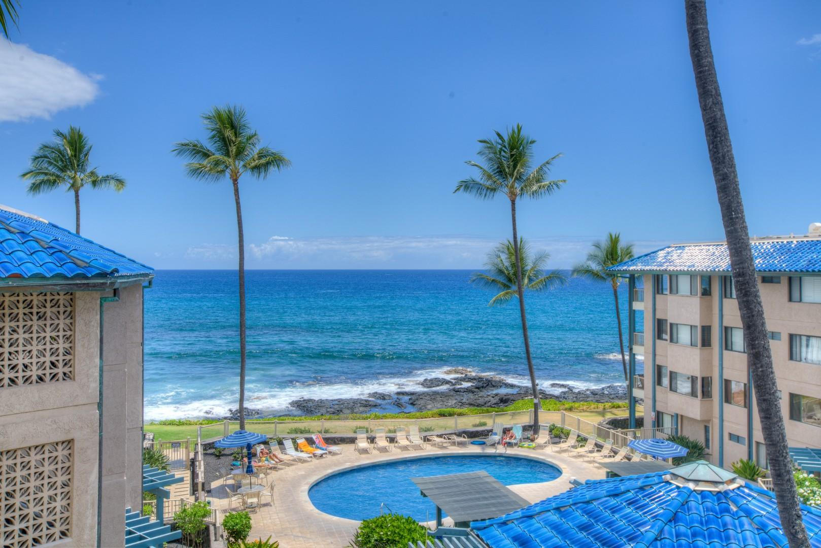 Actual View from Lanai of Unit F-11 over the Pool Area to the Ocean beyond.