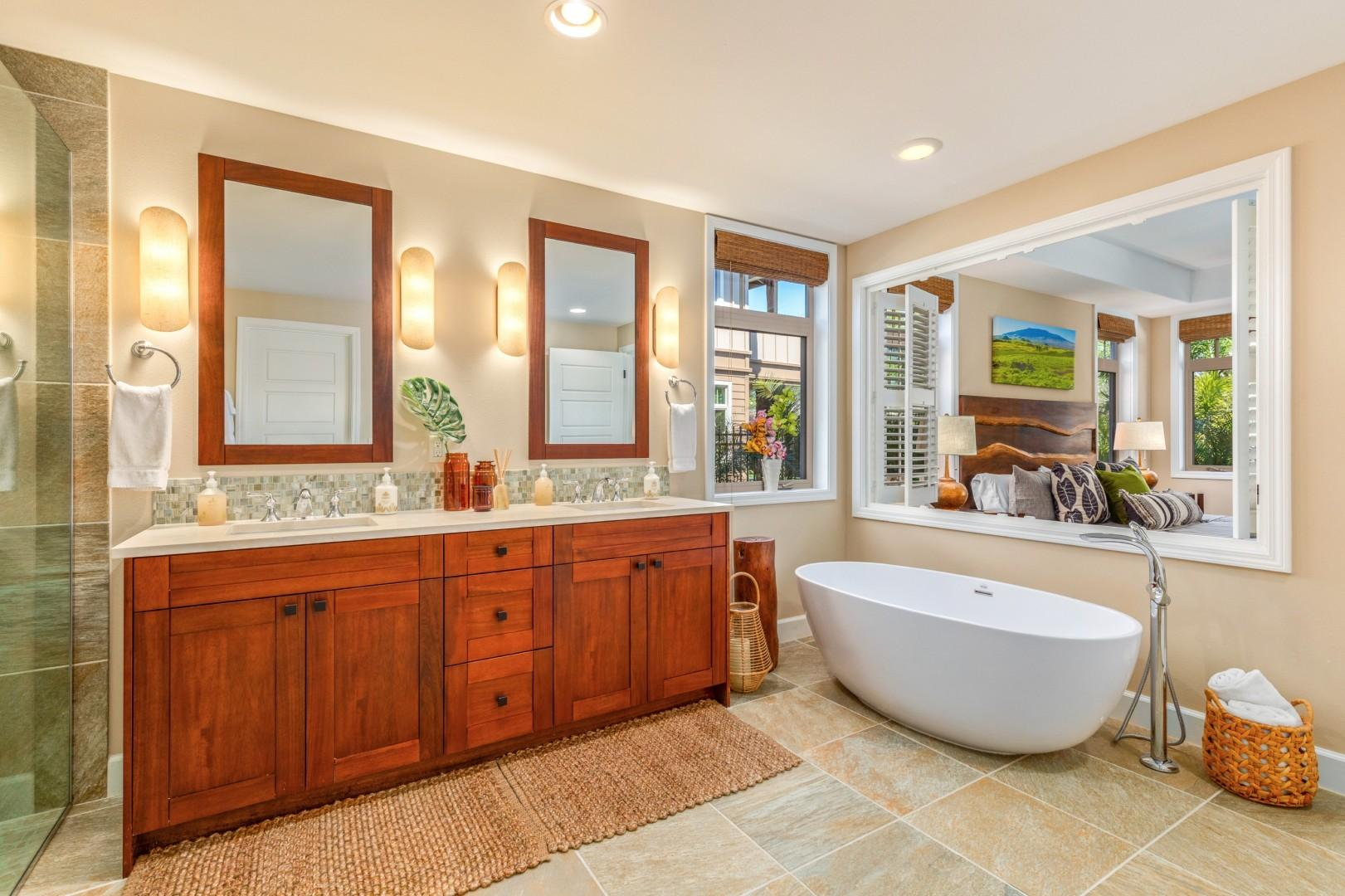 Master bath with oversized freestanding soaking tub, walk-in shower, dual vanity, W/C and walk-in closet.