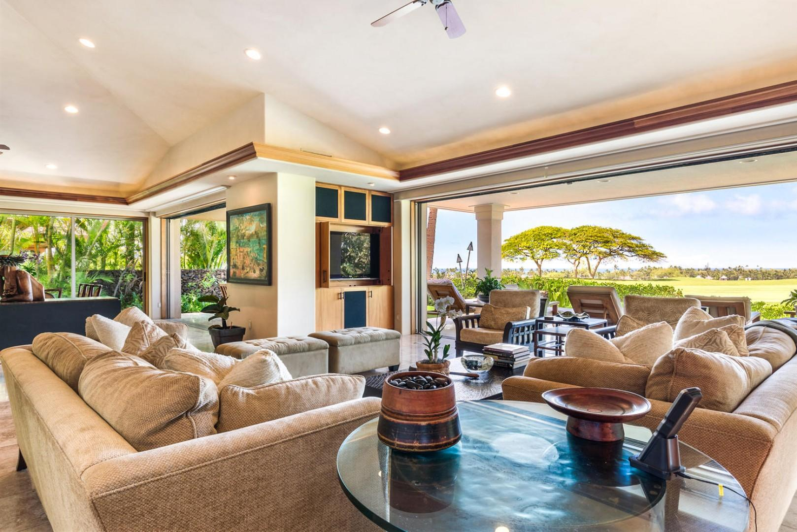 Alternate view of living area featuring two walls of pocket doors opening to outdoor living space.