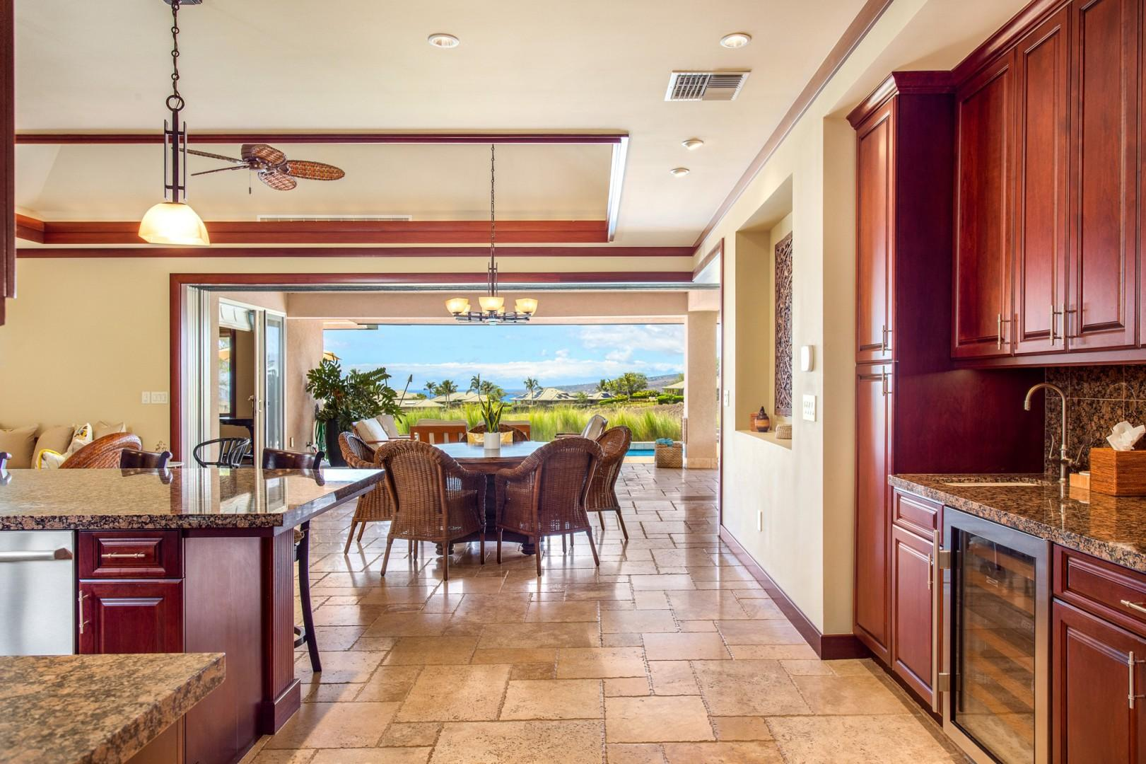The spacious and gleaming gourmet kitchen is outfitted with granite countertops, gleaming appliances and a sizable island.