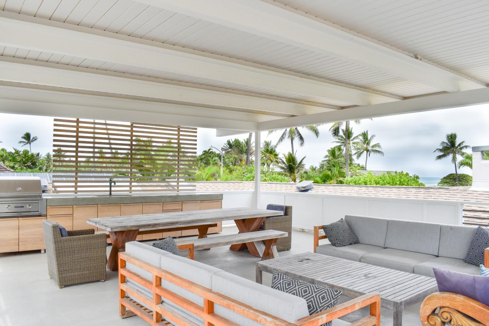 Roof top deck, with built in bbq, lounge and dining seating. Peak-a-boo ocean views!