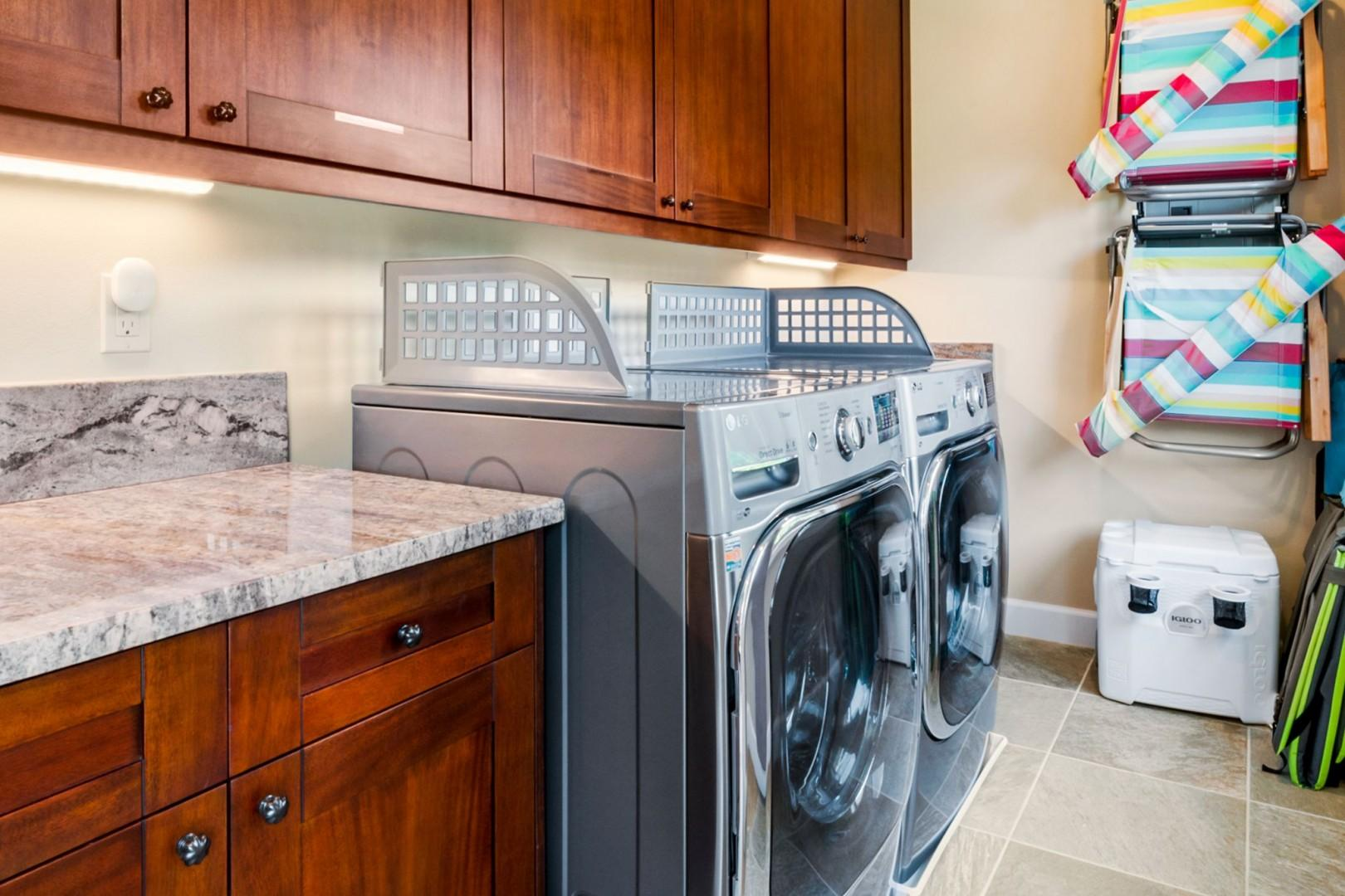 Full sized washer dryer in the well equipped laundry room
