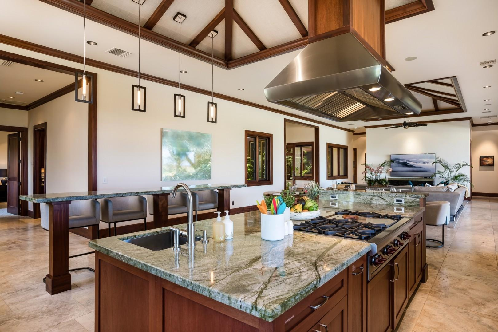Beautiful Ayers green granite slabs in fully equipped kitchen with top-tier appliances.